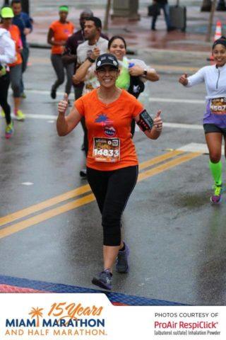 Miami Marathon Runner enjoys the Xpresso Band and DJ P-LO